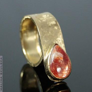 Asymetryczny złocony - kamień słoneczny